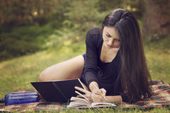 Woman writer is inspired by nature. Beautiful woman writer is inspired by nature Royalty Free Stock Photography