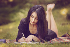 Woman writer is inspired by nature. Beautiful woman writer is inspired by nature Stock Photography