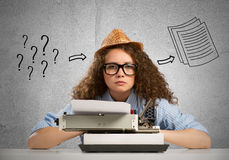Woman writer. Young pretty woman writer with typing machine stock images