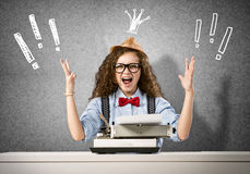 Woman writer. Young pretty woman writer with typing machine Royalty Free Stock Photography