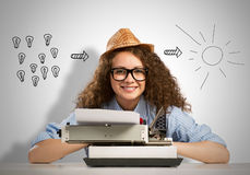 Woman writer. Young pretty woman writer with typing machine Royalty Free Stock Photo