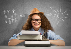 Woman writer. Young pretty woman writer with typing machine royalty free stock image