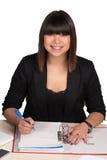 Woman writes into a file Royalty Free Stock Photo