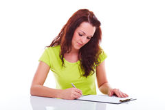 Woman writes on the folder Stock Images