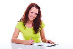 Woman writes on the folder Royalty Free Stock Photos