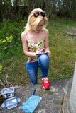 Woman writes in geocaching logbook Stock Photo
