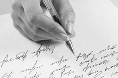 Woman writes a handwritten letter Stock Photos