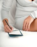 Woman writes a letter Stock Image