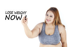 Woman writes lose weight now text Stock Image