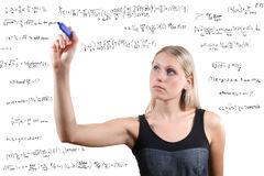 Woman writes mathematical equations Royalty Free Stock Images
