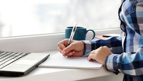 Woman writes in notebook Royalty Free Stock Images