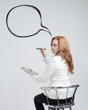 Woman writes in a painted  speech cloud Stock Images