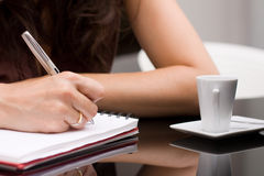 Woman writes on a paper Royalty Free Stock Photo