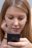 Woman writes an SMS Stock Photo