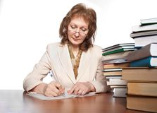 The woman writes to writing-books Royalty Free Stock Photos