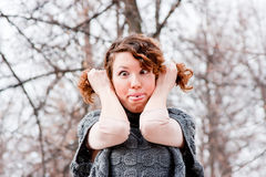 Woman writhes ugly faces. A young  woman writhes ugly faces Stock Photo