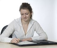Woman writing Stock Image
