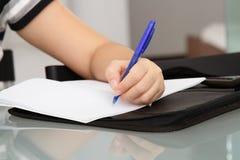 Woman writing Stock Image