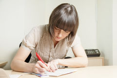 Woman writing Royalty Free Stock Images