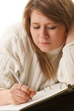 Woman writing Stock Photography