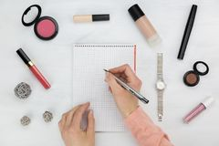 Woman writing on a notepad in a beauty concept stock images
