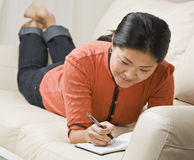 Woman Writing in Book Royalty Free Stock Image
