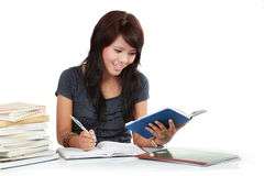 Woman writing in a book Royalty Free Stock Photos