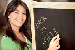 Woman writing on a chalkboard Stock Photos