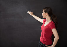 Woman writing on chalkboard Stock Image