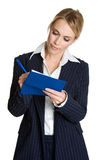 Woman Writing Check. Beautiful business woman writing check Royalty Free Stock Photo