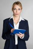 Woman Writing Check. Shocked business woman writing check Stock Photo