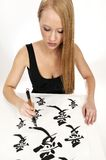 Woman writing Chinese Calligraphy: LOVE Stock Photography