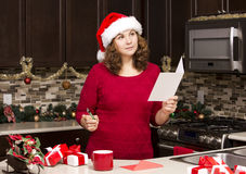 Woman writing Christmas card Stock Images