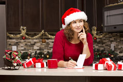 Woman writing Christmas card Royalty Free Stock Photos