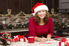 Woman writing Christmas card Stock Photography