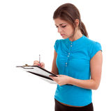 Woman writing on clipboard Royalty Free Stock Photography