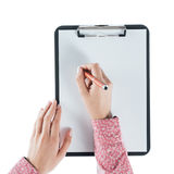 Woman writing on a clipboard Royalty Free Stock Image