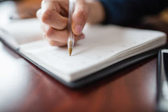 Woman writing in diary Stock Images