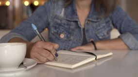 Woman is writing in diary. Woman is writing in journal, diary stock footage