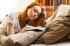 Woman writing diary or studying Stock Images