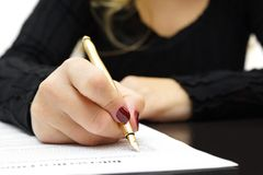 Woman is writing document Royalty Free Stock Photo