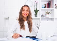 Woman writing down information Stock Images