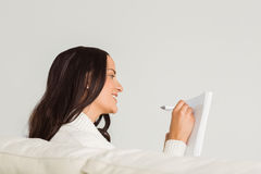 Woman writing down some notes Stock Photography