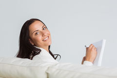 Woman writing down some notes Royalty Free Stock Photos