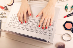 Woman writing fashion blog. laptop and accessories on the table Stock Photography