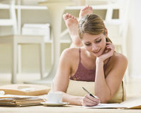 Woman Writing on Files Stock Image