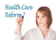 Woman writing health care reform Royalty Free Stock Image