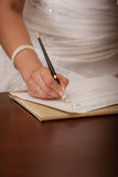 Woman writing on her agenda Stock Photography