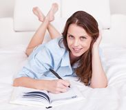 Woman writing in her diary Royalty Free Stock Photos