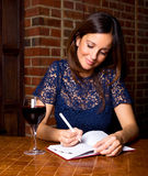 Woman writing in her diary Royalty Free Stock Image